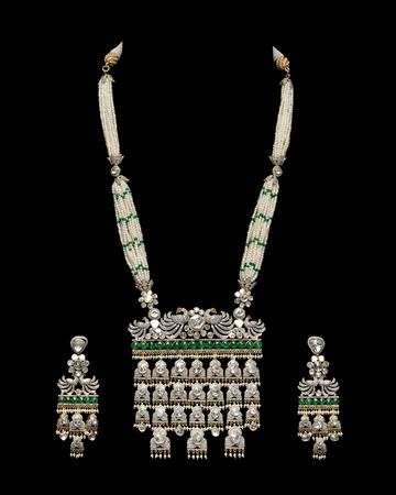 diamond earrings: Close up of diamond necklace with diamond earrings
