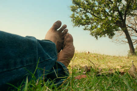 foots: Foots of a man in nature sitting and relaxing Stock Photo