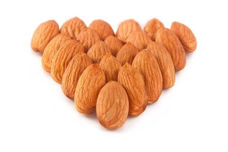 extreme macro: Pile of almonds isolated over white background Stock Photo