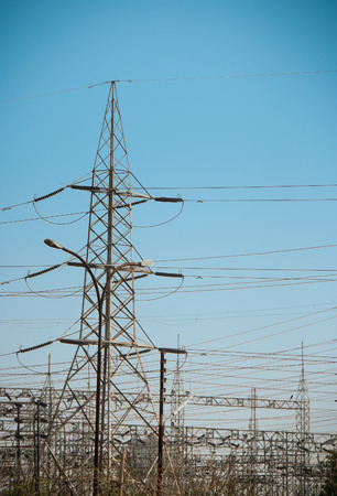 isolator insulator: Electricity pylons with a blue sky in evening Stock Photo