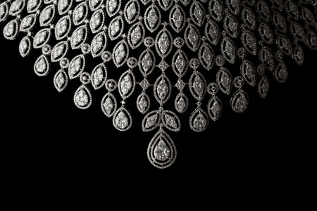 black stones: Close up of diamond necklace on black background Stock Photo