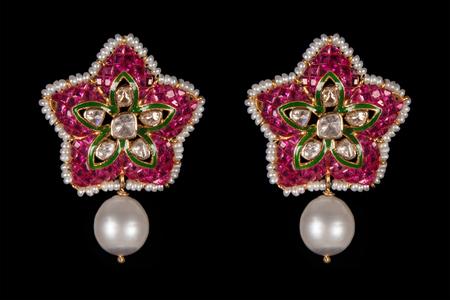 diamond earrings: Close up of pairs of diamond earrings