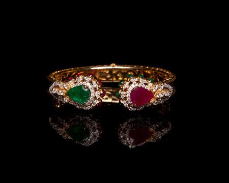 bangle: Close up of diamond bangle over black background Stock Photo