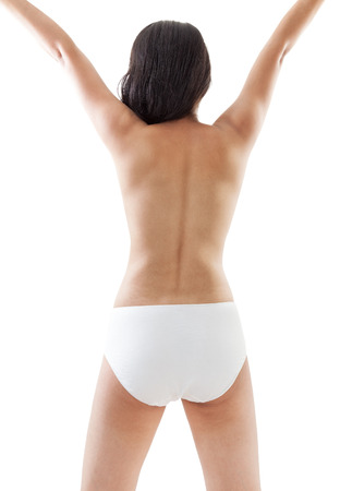 back up: Back view of an indian nude girl raising up her arms
