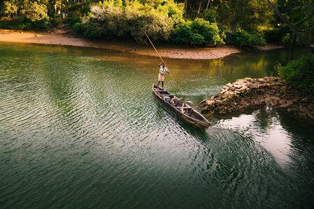 india fisherman: Beautiful view of small fishing boat on the lake Stock Photo