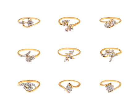 Collage of diamond rings on white background photo