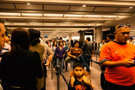 chek: People waiting for immigration at Chek Lap Kok, Hong Kong International Airport. Hong Kong SAR, 20 June, 2013