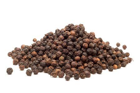 Pile of Organic Black pepper Piper nigrum isolated on white background. Stock Photo