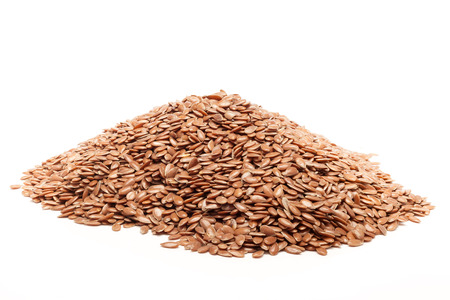 linum: Pile of Organic Linseed or Flaxseed Linum usitatissimum isolated on white background. Stock Photo