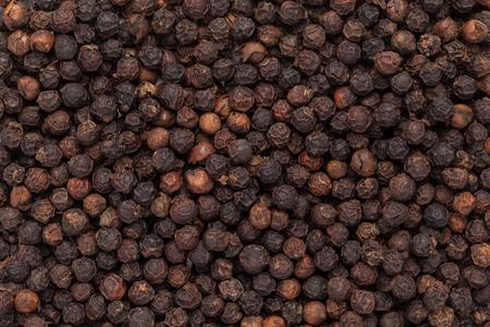pepe nero: Il pepe nero organico Piper nigrum primo piano texture di sfondo. Archivio Fotografico