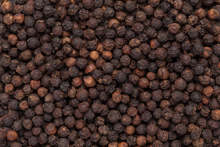 pepe nero: Organic Black pepper Piper nigrum closeup background texture.