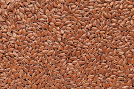 linum usitatissimum: Organic Linseed or Flaxseed Linum usitatissimum closeup background texture. Stock Photo