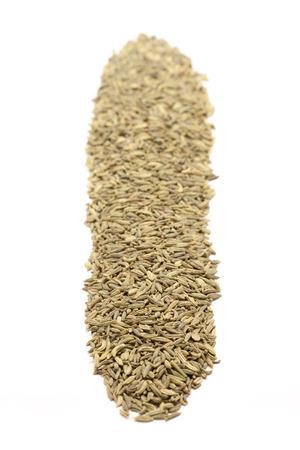 saunf: Row of Organic Aniseed Pimpinella anisum isolated on white background. Stock Photo