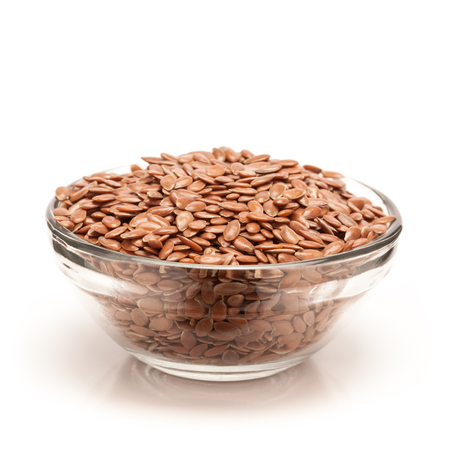 usitatissimum: Front view of Organic Linseed or Flaxseed Linum usitatissimum in glass bowl isolated on white background.