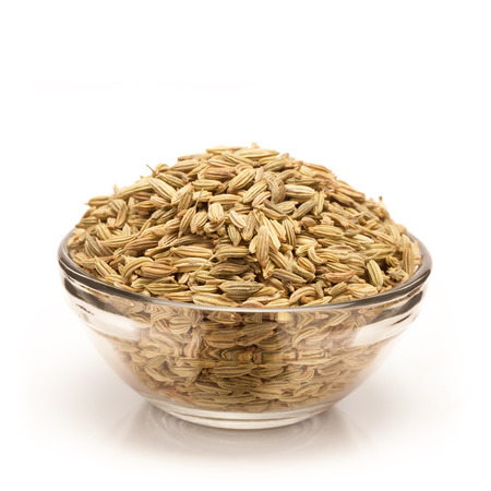 fennel seed: Front view of Organic Fennel seed Foeniculum Vulgare in glass bowl isolated on white background.
