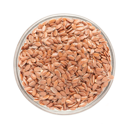 linum: Top view of Organic Linseed or Flaxseed Linum usitatissimum in glass bowl isolated on white background.