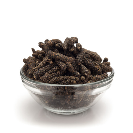 piper: Front view of Organic Long pepper Dried Fruit Piper longum in glass bowl isolated on white background.