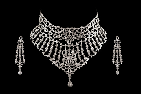 diamond necklace: Close up of diamond necklace on black background with diamond earrings.