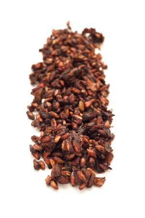 punica granatum: Row of Organic Dried Pomegranate Punica granatum isolated on white background.