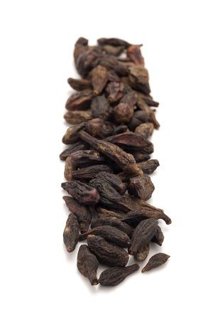 myrobalan: Row of Organic Chebulic Myrobalan or Choti Harad Terminalia chebula isolated on white background.