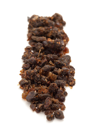 myrrh: Row of Organic Indian bdellium or Guggul resin Commiphora wightii isolated on white background.