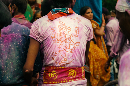 during: Devotee wearing Tshirts with Hindu God Idol and Om printed on it, during Ganpati Festival, 27 Sep 2015, Kanpur, INDIA