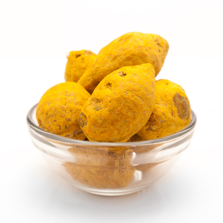curcumin: solid, isolated, collection, spice, indian, bowl, organic, yellow, pile, roots, condiment, rhizomes, herbs, ingredients, dry, medicine, glass, round turmeric, front view, curcuma longa, haldi, ayurvedic, zingiberaceae, curcumin Stock Photo