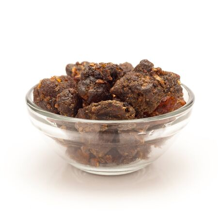 myrrh: Front view of Organic Indian bdellium or Guggul resin Commiphora wightii in glass bowl isolated on white background.
