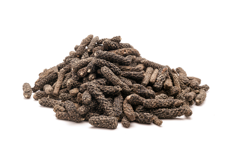myrobalan: Pile of Organic Long pepper Dried Fruit Piper longum isolated on white background. Stock Photo