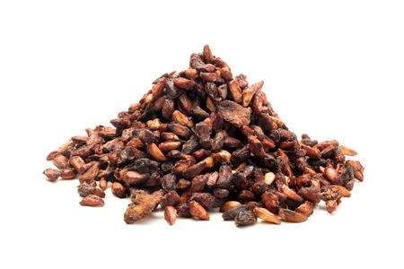 punica granatum: Pile of Organic Dried Pomegranate seeds Punica granatum isolated on white background. Stock Photo