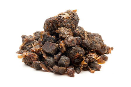 Pile of Organic Indian bdellium or Guggul resin Commiphora wightii isolated on white background.
