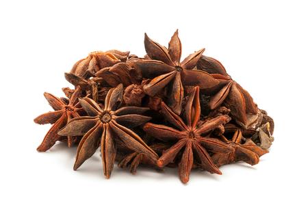 chakra: Pile of Organic Star anise or Chakra Phool Illicium verum isolated on white background. Stock Photo