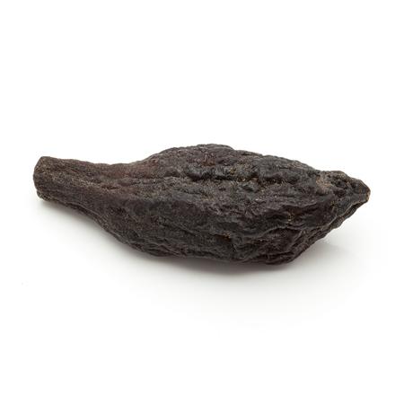 myrobalan: Macro closeup of Organic Chebulic Myrobalan or Choti Harad Terminalia chebula isolated on white background. Stock Photo