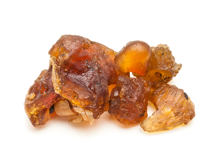 Macro closeup of Organic Indian bdellium or Guggul resin Commiphora wightii isolated on white background.