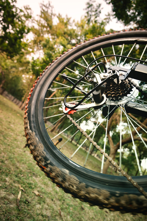 gearshift: Close up of a moving mountain bicycle rear wheel with details, chain and gearshift mechanism. Stock Photo