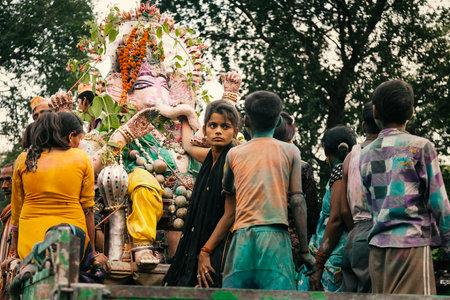 immersion: People carrying Hindu God Idol Ganesh for Holy Immersion Ganpati Visharjan at The Ganges River, 27 Sep 2015, Kanpur, INDIA