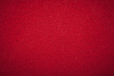 solid color: Background texture of solid red color made of soil.