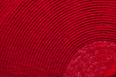 solid color: Close up spiral background texture of solid red color made of soil. Stock Photo