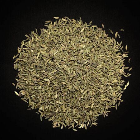 saunf: Top view of Organic Aniseed Pimpinella anisum isolated on dark background. Stock Photo
