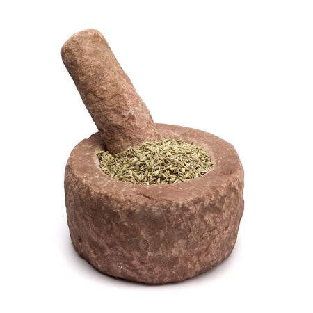 Organic Fennel seed Foeniculum Vulgare in mortar with pestle, isolated on white background.