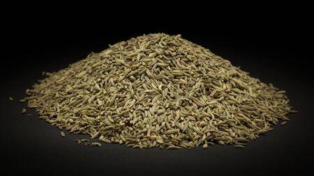 saunf: Pile of Organic Aniseed Pimpinella anisum on dark background.