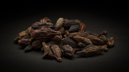 myrobalan: Pile of Organic Chebulic Myrobalan or Choti Harad Terminalia chebula on dark background.