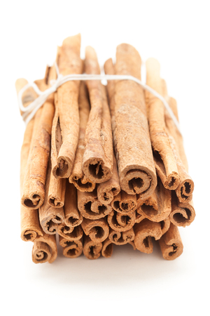 cinnamomum: Top front view of Raw Organic Cinnamon sticks (Cinnamomum verum) bundle tied up with thread. Stock Photo
