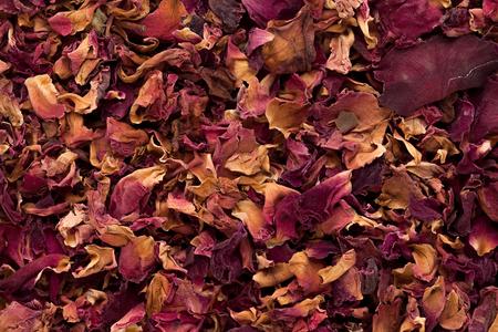 dried herb: Macro closeup background texture of Organic Damask rose petals (Rosa damascena). Stock Photo