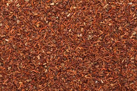 mahogany: Organic Red Mahogany or Eucalyptus (eucalyptus pellita) seeds. Macro closeup background texture. Top View. Stock Photo