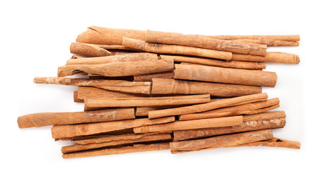 cinnamomum: Raw Organic Cinnamon sticks (Cinnamomum verum) isolated on white background. Top view. Stock Photo