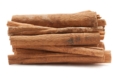 cinnamomum: Raw Organic Cinnamon sticks (Cinnamomum verum) isolated on white background. Macro closeup Front view. Stock Photo