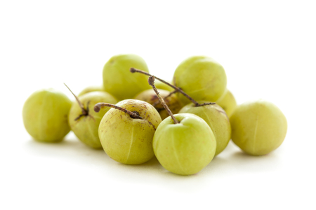 traditional remedy: Collection of Organic Indian gooseberry or Amla (Phyllanthus emblica) isolated on white background.