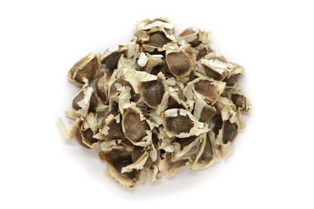 the drumstick tree: Organic Moringa (Moringa oleifera) seeds isolated on white background. Macro close up. Top view.