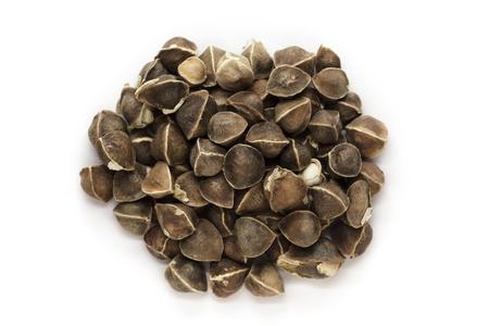 Organic Wingless Moringa (Moringa oleifera) seeds isolated on white background. Macro close up. Top view. Stock Photo